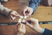 Strategy And Solution Business Concept.group Of Business People Holding Piece Of Jigsaw Puzzle To So poster