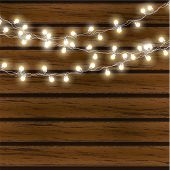 Christmas Lights Isolated On Dark Wooden Background. Glow Garland. Vector Glow Xmas Light Bulbs On W poster