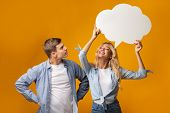Happy Blonde Girl Holding Speech Bubble Over Her Head, Curious Guy Trying To Guess What She Thinking poster