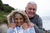 Portrait of senior couple having fun together at beach poster