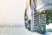 Close-up Of Car Wheels Rubber Tires In Deep Winter Snow. Transportation And Safety Concept. poster