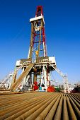 foto of oil derrick  - A land drilling rig in China Shengli Oil Plant - JPG
