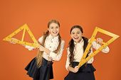 Kids School Uniform On Orange Background. Pupil Cute Girls With Big Rulers. Geometry School Subject. poster