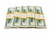 stock photo of ten thousand dollars cash  - Ten thousand dollar stacks on the white - JPG