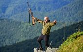 Walking In Mountains. Hunting Masculine Hobby Concept. Regulation Of Hunting. Hunter Hold Rifle. Nic poster