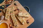 Healthy Homemade Granola Cereal Bars With Nuts, Dried Berries And Honey. Flat Lay Overhead With Copy poster