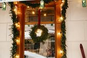 Stylish Christmas Wreath With Fir Branches And Lights At Front Window Of Store At Holiday Market In  poster