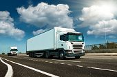 White truck is on highway - business, commercial, cargo transportation concept, clear and blank spac poster