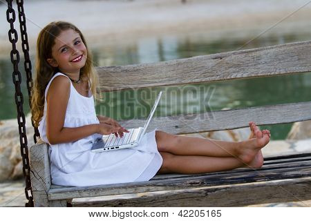 Girl with netbook - Lovely girl with netbook resting on the beach