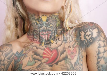Midsection of tattooed woman