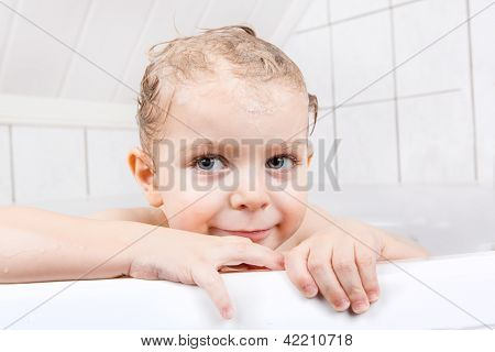 Adorable Toddler Boy Having Fun In Bathtub