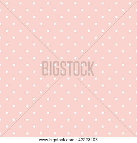 Seamless vector pattern with white polka dots on a pastel pink background.
