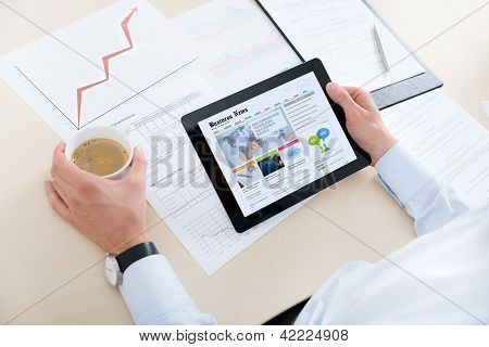 Businessman Reading Latest News