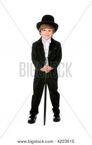 Grinning Young Boy In Black Tuxedo