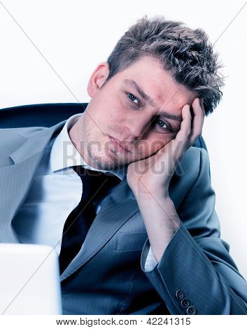 Portrait Of  Exhausted Businessman At The Office