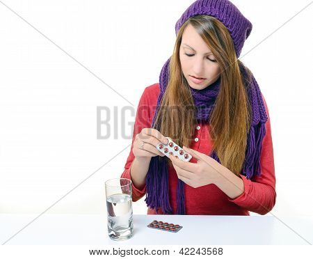 Beautiful Girl Taking Medicine Against A White Background