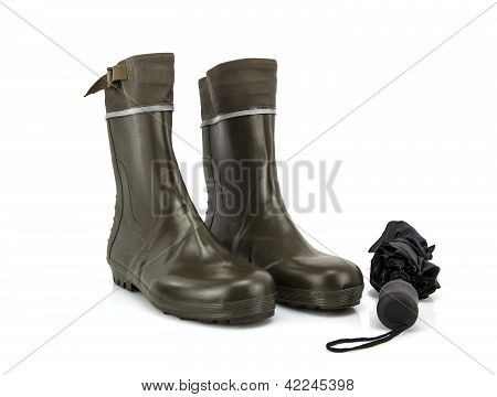 Wellington Boots With Umbrella On White Background
