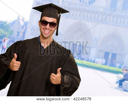 Graduate Man With Double Thumb Up Sign, Outdoor
