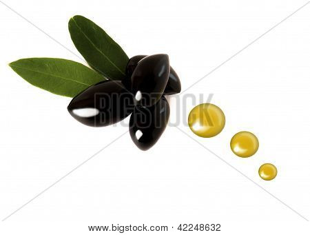 Several Black Olives With Oil Drops