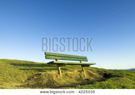 Green Seat On Hill