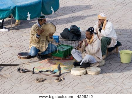 Snake Charmer At Djemaa El Fna Square In Marrakech