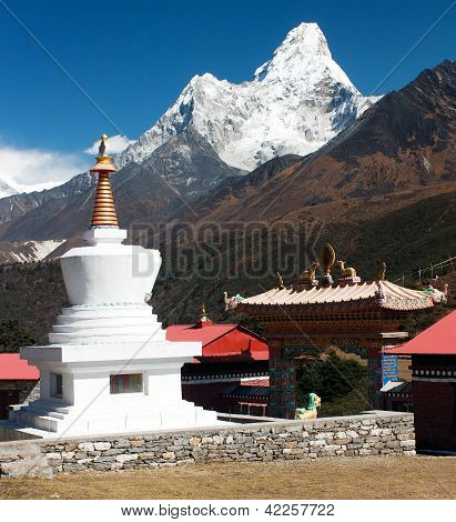 Stupa in Tengboche monastery with mount Ama Dablam on the way to Everest base camp