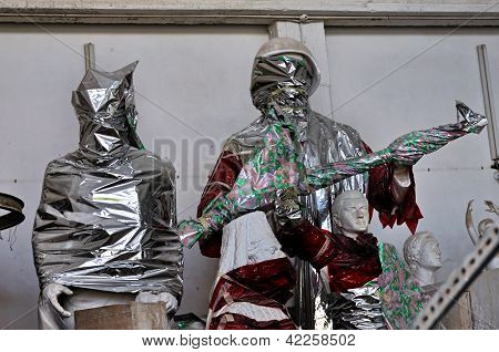 Statues Wrapped In Plastic