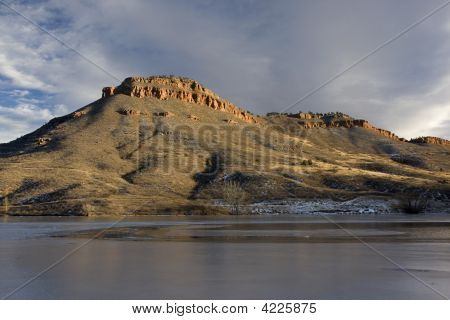 Hills, Sandstone Cliffs And Freezing Lake In Colorado