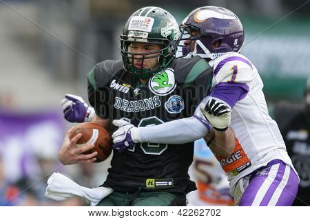 VIENNA, AUSTRIA - MARCH 31 WR Thomas Haider (#13 Dragons) is tackled by DB Tillman Stevens (#1 Vikings) on March 31, 2012 in Vienna, Austria.