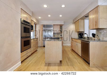 Kitchen with island and wood cabinetry