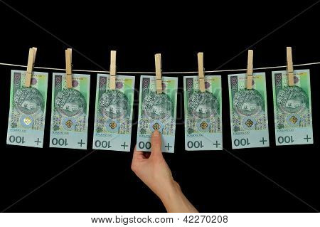 Dirty Money Hanging From A Clothesline Isolated On Black