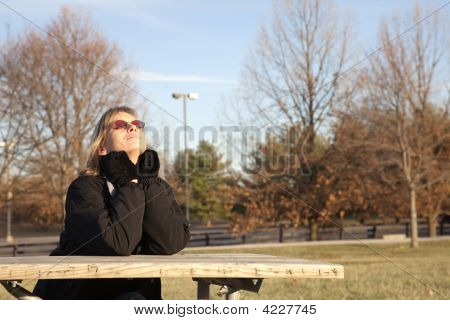 Woman Basking In Winter Sun