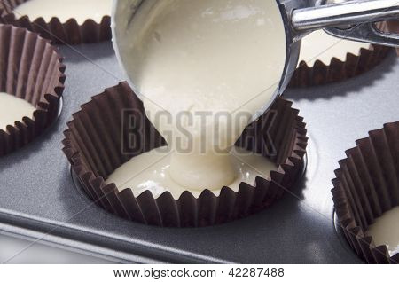 Filled Cupcake Cases With Vanilla  Mixture