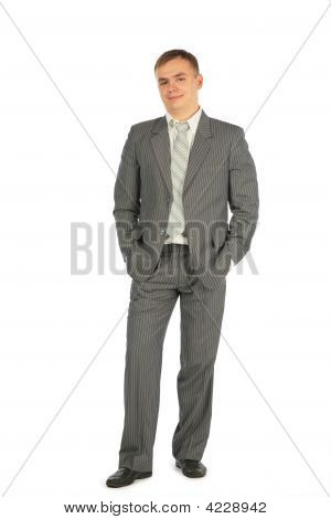 Man In Suit Stand On A White Background