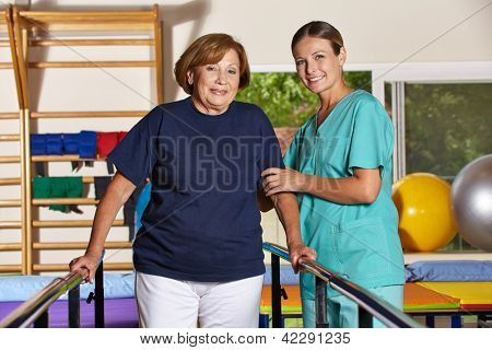 Senior woman doing kinesiotherapy in rehab with physiotherapist