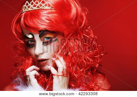 Princess with bright red hair and creative visage. Holiday theme.