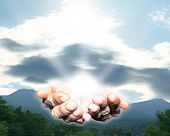 stock photo of hand god  - The hands of the creator offering the gift of life - JPG