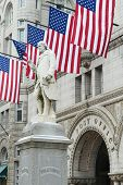 Washington DC, Old Post Office building with Benjamin Franklin Statue foreground