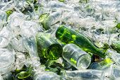 stock photo of reprocess  - recovery of waste glass in a recycling plant - JPG