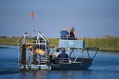 stock photo of airboat  - Airboat ride in the Florida Everglades Park - JPG