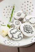 stock photo of decoupage  - White Easter eggs decorated with baroque decoupage - JPG