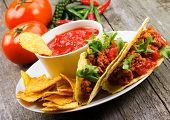 stock photo of junk  - plate with taco nachos chips and tomato dip - JPG