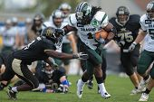 VIENNA, AUSTRIA - APRIL 21 RB Tunde Ogun (#1 Dragons) is tackled by Zacchaeus Mccaskill (#3 Rangers)