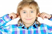 Portrait of a funny 9 year boy holding his ears. Isolated over white background.