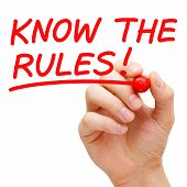 stock photo of faq  - Hand writing Know The Rules with red marker on transparent wipe board - JPG