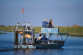 foto of airboat  - Airboat ride in the Florida Everglades Park - JPG