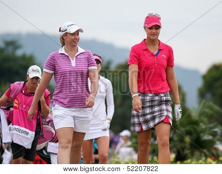 KUALA LUMPUR - OCTOBER 12: Brittany Lincicome and Anna Nordqvist (red cap) walks to the Hole 3 fairway of KLGCC course on Day 3 of the Sime Darby LPGA on October 12, 2013 in Kuala Lumpur, Malaysia.