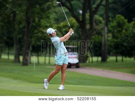 KUALA LUMPUR - OCTOBER 12: Mamiko Higa of Japan hits toward the 2nd hole green of the KLGCC course on Day 3 of the Sime Darby LPGA on October 12, 2013 in Kuala Lumpur, Malaysia.