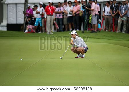 KUALA LUMPUR - OCTOBER 12: So Yeon Ryu of South Korea lines up her putt at the 2nd hole green of the KLGCC course on Day 3 of the Sime Darby LPGA on October 12, 2013 in Kuala Lumpur, Malaysia.