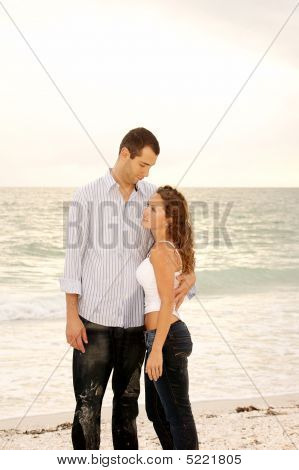 Tall Man Holding Shorter Woman